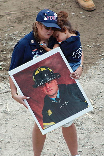 Mourners Gather At Ground Zero For Memorial