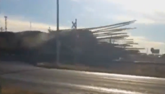 train hits log truck