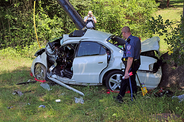Cpl. Brad Davis and Officer Randy Stallard investigate the scene of a fatal crash on Gobblers Knob Road.  (LPD photo)