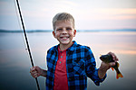 Blond Boy Catching Fish